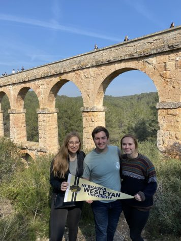 Grady Kershner (middle) meets up with fellow NWU students Maddie Rappl (left) and Sierra Richey (right) at Point del Diable in Tarragona, Spain to learn about Sierra's host city.